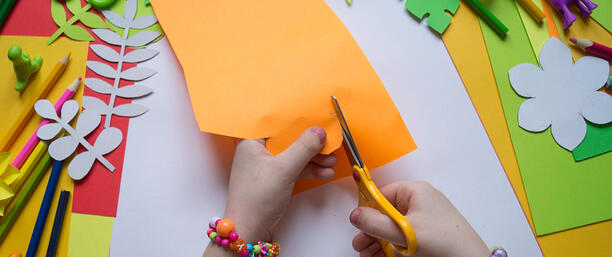 Child cutting shapes out of paper